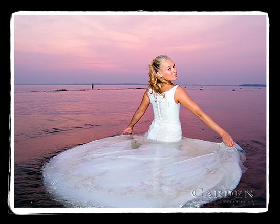 trash the dress in lake mendota in madison wisconsin of a bride after her wedding bride