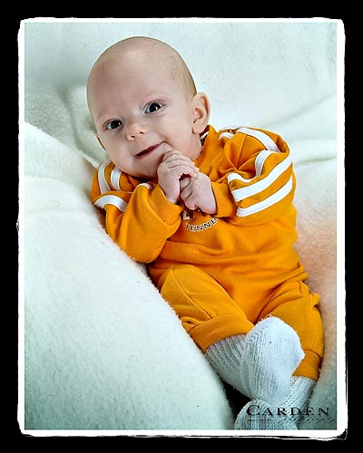 baby in Tennessee Vols orange romper
